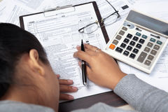 Woman stress with tax form Stock Photos