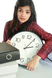 Woman stress at work. Businesswoman holding a clock. dateline stress at work concept Royalty Free Stock Photos