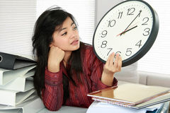 Woman stress at work. Businesswoman holding a clock. dateline stress at work concept Stock Photo
