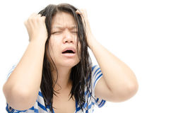 Woman stressed is going crazy pulling her hair in frustration. Stock Images
