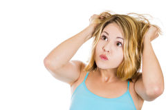 Woman stressed is going crazy pulling her hair in frustration Stock Image