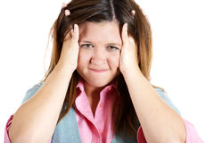 Woman stressed is going crazy pulling her hair in frustration. Royalty Free Stock Photos