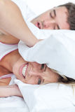 Woman stressed by her boyfriend's snores Stock Photo