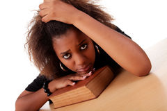 Woman stressed ,with her head resting upon book Royalty Free Stock Photo