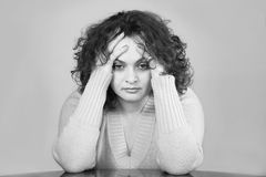 Woman stressed out. Young woman with sad expression Stock Image
