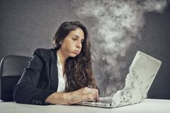 Woman stressed by overwork with the laptop melting. Businesswoman tired and bored by her heavy work stock photos