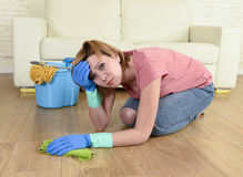 Woman stressed and tired cleaning the house washing the floor on her knees Royalty Free Stock Photo
