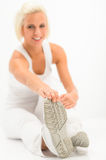 Woman stretch leg white fitness exercise Stock Photography