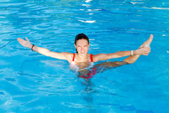 Woman  Stretch in water Royalty Free Stock Image