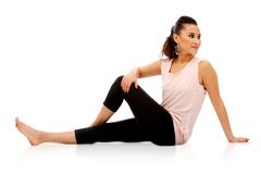 Woman stretches Stock Photography