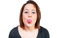 Woman stretches cheeky tongue out Royalty Free Stock Photography
