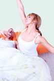 Woman stretches while man yawning Stock Photos