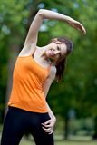 Woman stretching Royalty Free Stock Images