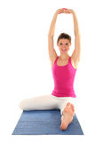 Woman Stretching. On A Yoga Mat Stock Photo