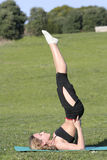 Woman stretching. In the park Royalty Free Stock Images