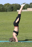 Woman stretching. In the park Royalty Free Stock Image