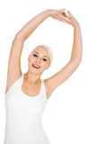 Woman stretching Stock Images