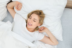 Woman Stretching Arms In Bed Royalty Free Stock Photo