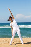 Woman stretching on beach Royalty Free Stock Image