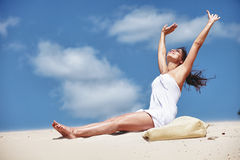 Woman stretching on beach Stock Photos