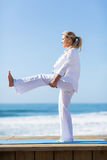 Woman stretching beach Stock Image
