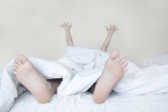 Woman stretching in bed Royalty Free Stock Image