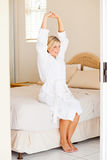 Woman stretching on bed Royalty Free Stock Photo