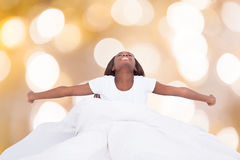 Woman Stretching In Bed Royalty Free Stock Photo