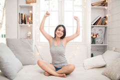 Woman stretching in bed after waking up, back view, entering a day happy and relaxed after good night sleep. Sweet dreams, good mo. Rning, new day, weekend royalty free stock images