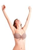 Woman Stretching in Bikini. Woman stretching, wearing a bikini, isolated in a white background Royalty Free Stock Image