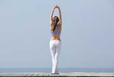 Woman stretching body before workout Royalty Free Stock Images