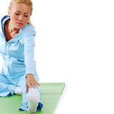 Woman stretching close up on white Stock Photo