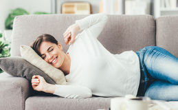 Woman stretching on the couch Royalty Free Stock Photos