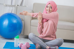 Woman stretching while doing exercise at home Royalty Free Stock Photography