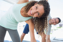 Woman stretching in exercise room Royalty Free Stock Photography