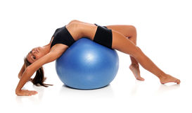 Woman Stretching On Fitness Ball Stock Photo