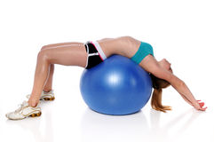 Woman Stretching On Fitness Ball Royalty Free Stock Photos