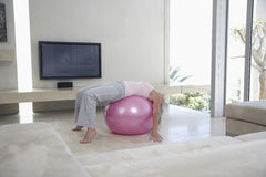 Woman Stretching On Fitness Ball Royalty Free Stock Photography