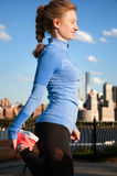 Woman stretching before fitness in park view Manhattan Royalty Free Stock Photography