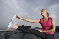 Woman Stretching On Foot Bridge Stock Photography