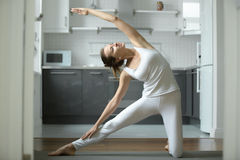 Woman stretching in Gate exercise Stock Image
