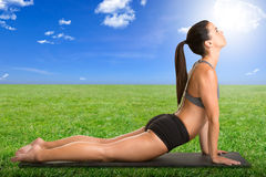 Woman Stretching on a Green Field Royalty Free Stock Photography