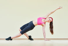 Woman stretching in gym Stock Photos