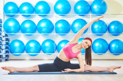 Woman stretching in gym Royalty Free Stock Image