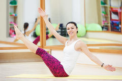 Woman stretching in gym Royalty Free Stock Photo