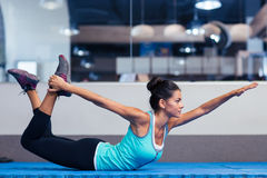 Woman stretching in gym Stock Images