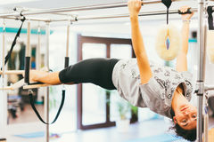 Woman stretching in a gym Stock Images