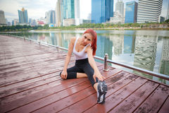 Woman stretching hamstring leg muscles Royalty Free Stock Images