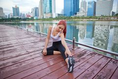 Woman stretching hamstring leg muscles Stock Images
