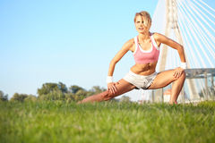 Woman stretching hamstring leg muscles Stock Photo